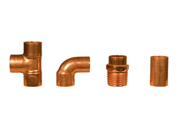 various copper plumbing fittings stock photo