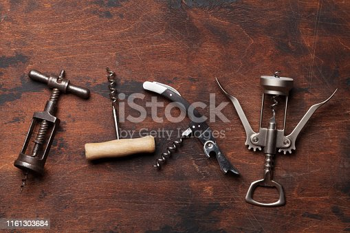 Various wine corkscrews on wooden table. Top view flat lay with copy space for your text