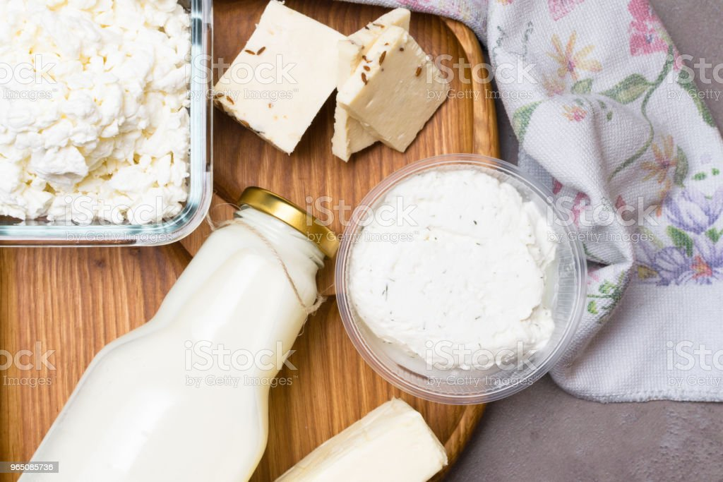 various dairy product on grey table with flower towel. Calcium source zbiór zdjęć royalty-free
