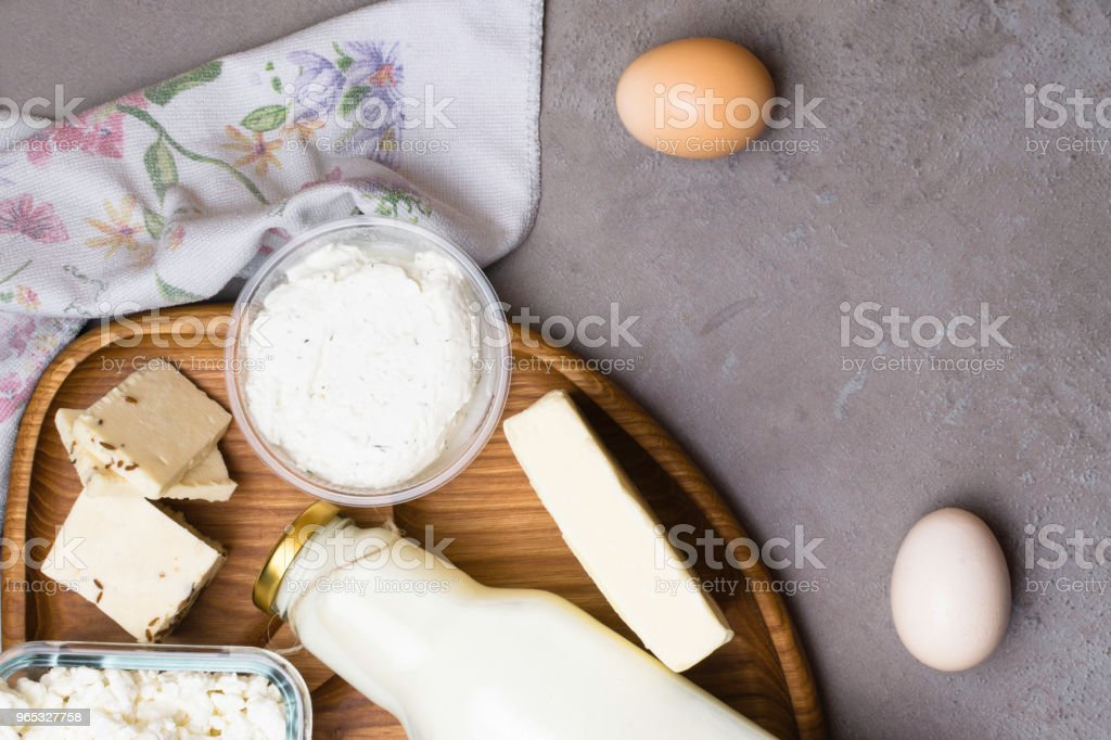 various dairy product on grey table with flower towel. Calcium source royalty-free stock photo