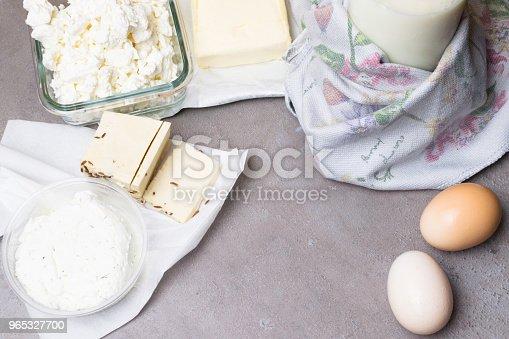 Various Dairy Product On Grey Table With Flower Towel - Stockowe zdjęcia i więcej obrazów Białko