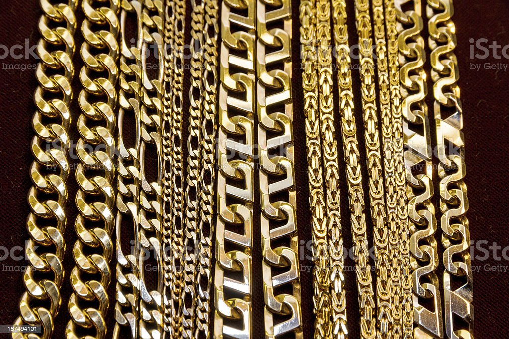 Various designs of gold chains  stock photo