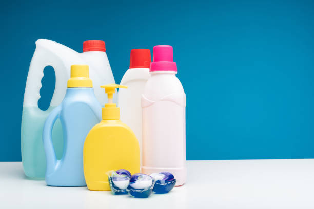 Various detergents put on white table Close up of washing capsules lying together with different washing liquids, soap, softener and bleach. Copy space in right side laundry detergent stock pictures, royalty-free photos & images