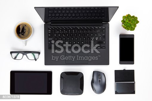 istock Various Devices Arranged On White Office Desk 822871378