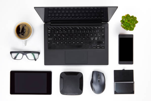 Various Devices Arranged On White Office Desk stock photo