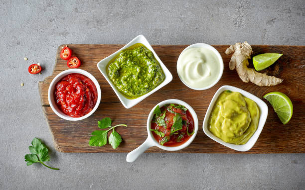 various dip sauces on grey table stock photo