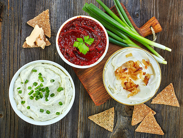 various dip sauces Various dip sauces and bread crackers on wooden table, top view dipping sauce stock pictures, royalty-free photos & images