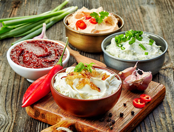 various dip sauces - savory food stock photos and pictures