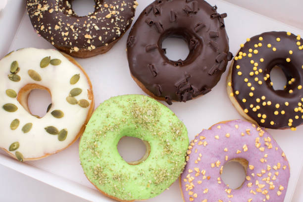 Various donuts lying in box stock photo