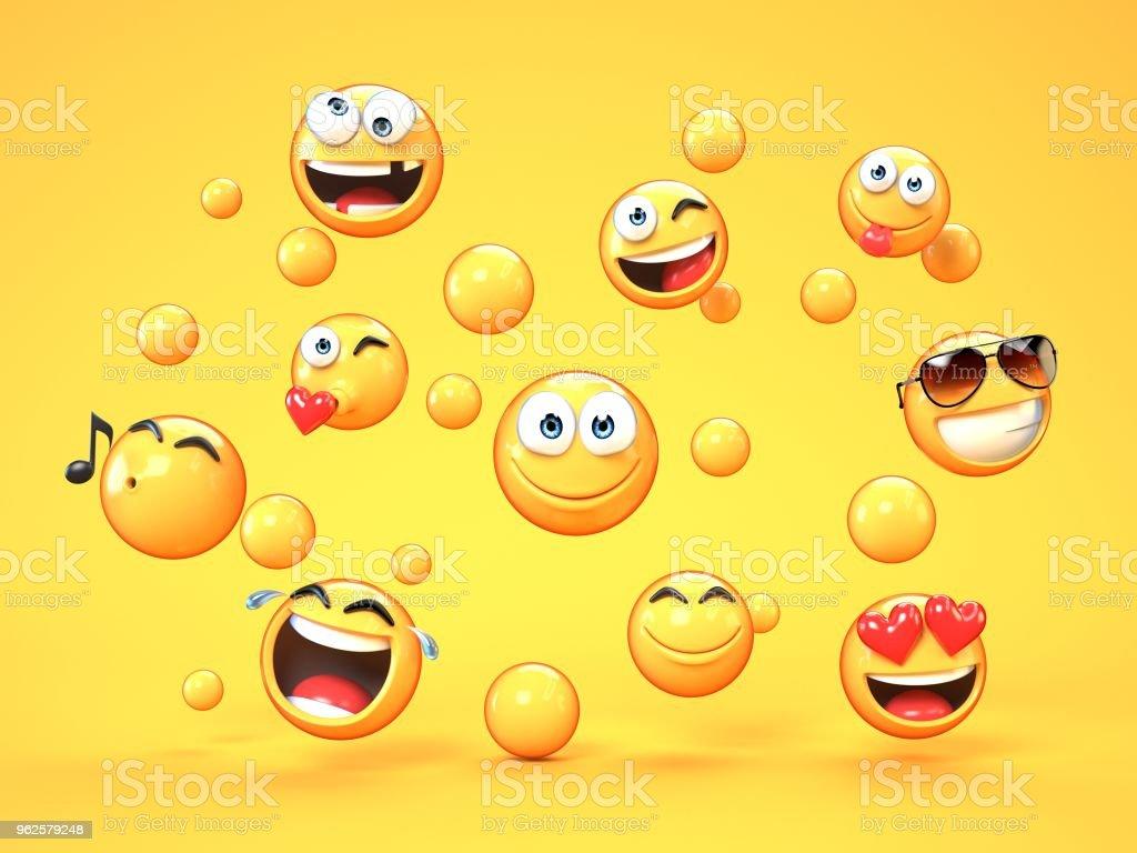 Various emojis on yellow background stock photo