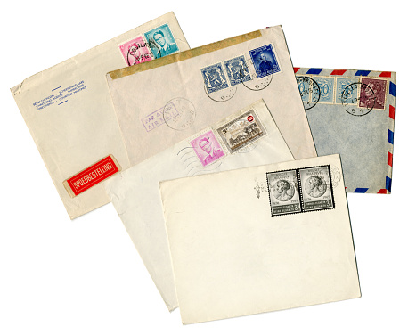 A group of five envelopes posted in Belgium in various years. ((Names and addresses removed.)