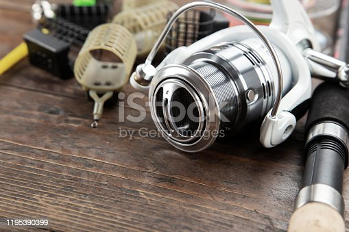 Various fishing equipment on a wooden background