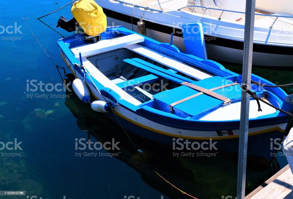 Fishing, power and row boats moored in harbor Palermo, Sicily, Italy