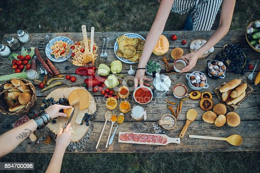 Overhead image of various homegrown food, vegetables and meat, on an old wooden table. Healthy eating. Organic foods in the outdoors.