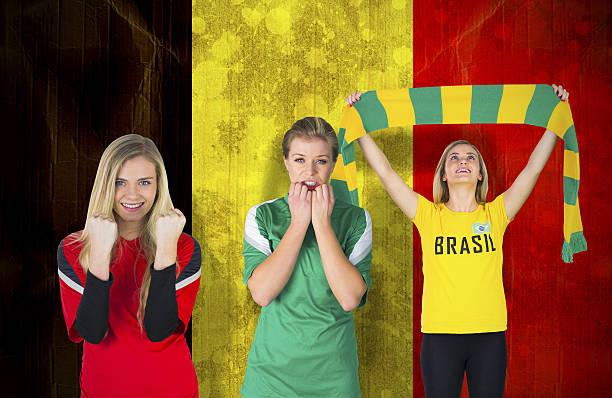Various football fans stock photo
