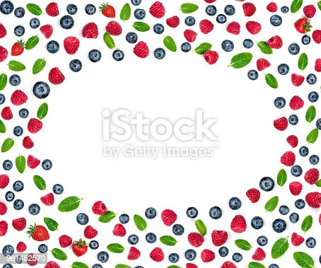 879258868 istock photo Various fresh berries isolated on white background, close up. Flying Strawberry, Mint, Raspberry and Blueberry. Food Frame