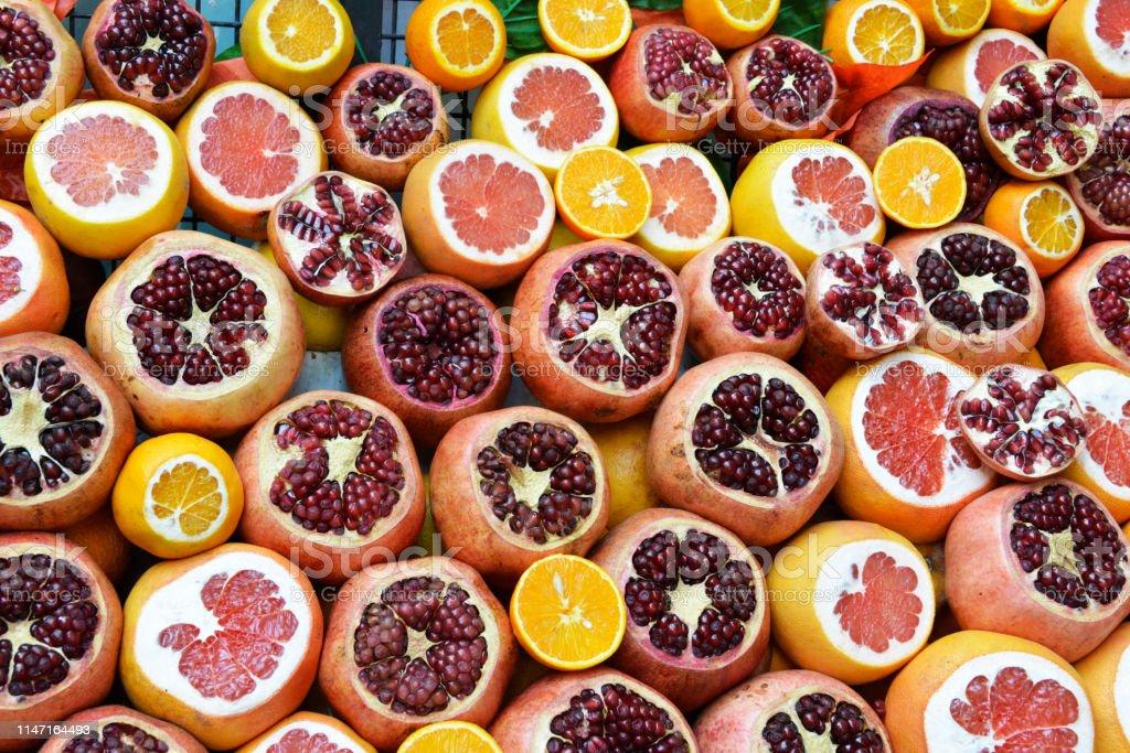 Pomegranates, oranges, grapefruits