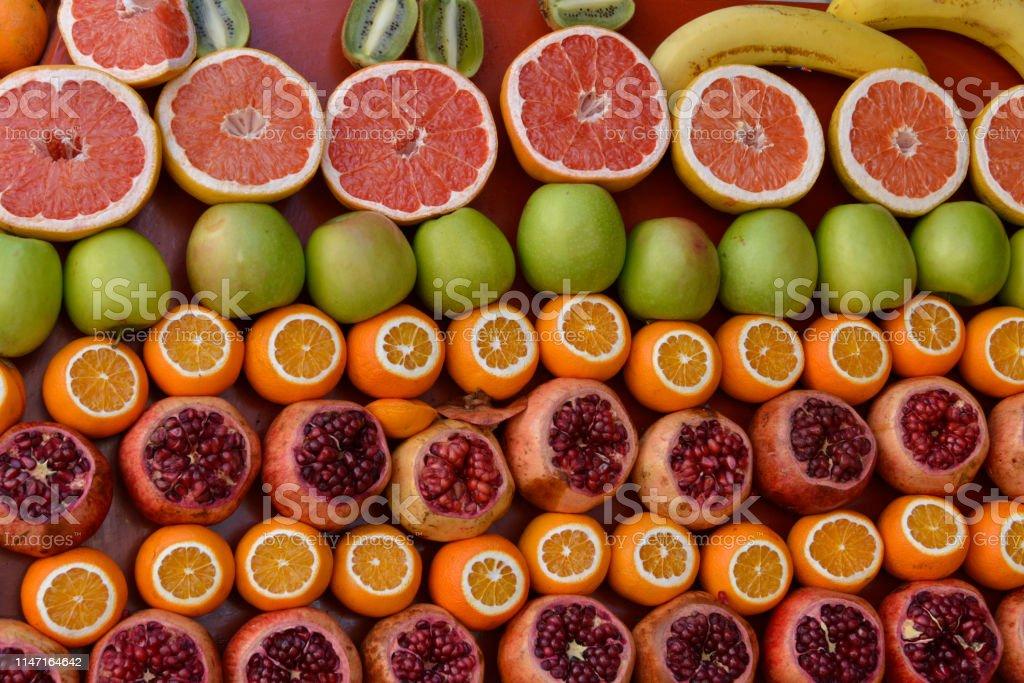 Pomegranates, oranges, grapefruits, apples, kiwis, bananas
