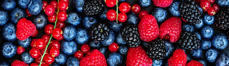 istock Various fresh summer berries Background. Panorama. Top view. Strawberry, Raspberry, Red currant,  Blueberry and Blackberry 1127297419