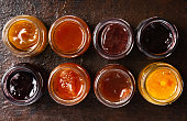 istock Various fruit jams in jars top view 1069748154
