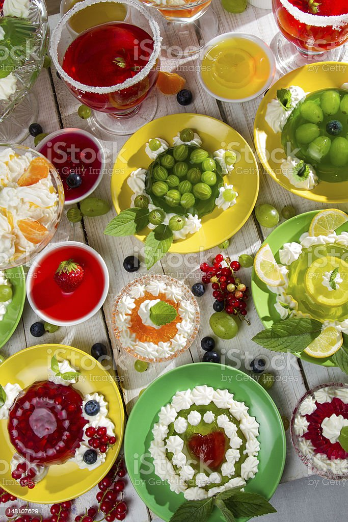 Various fruit jelly with cream royalty-free stock photo