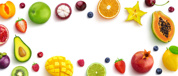 Various fruits and berries isolated on white background, top view, creative flat layout, round frame of fruits with empty space for text stock photo