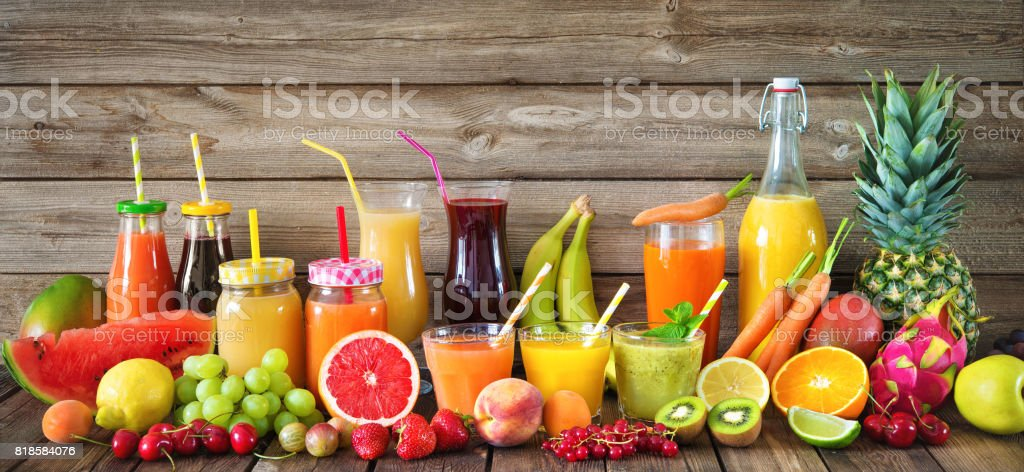 Various fruits and vegetables juices stock photo