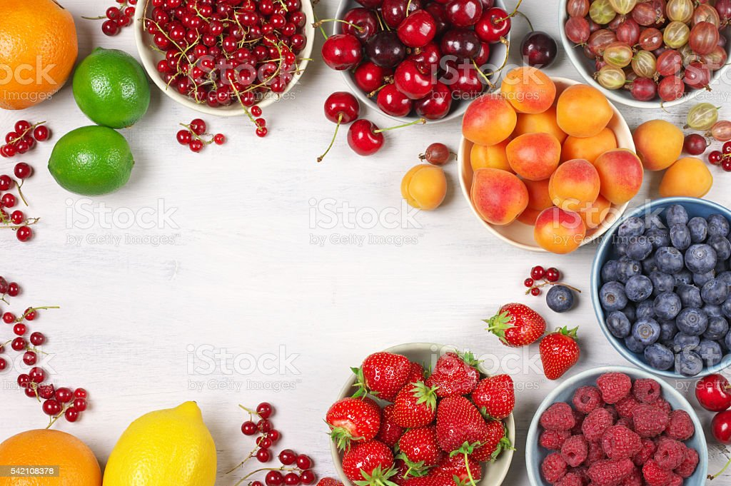 Various fruits in bowls stock photo