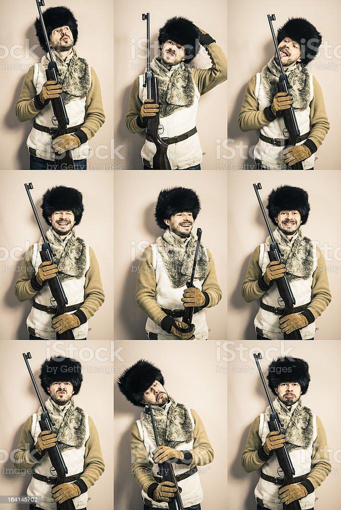 Various funny man's hunter portraits with shotgun, against wall, studio stock photo