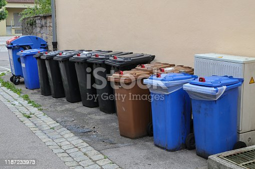 istock Various garbage cans stand on the street 1187233973