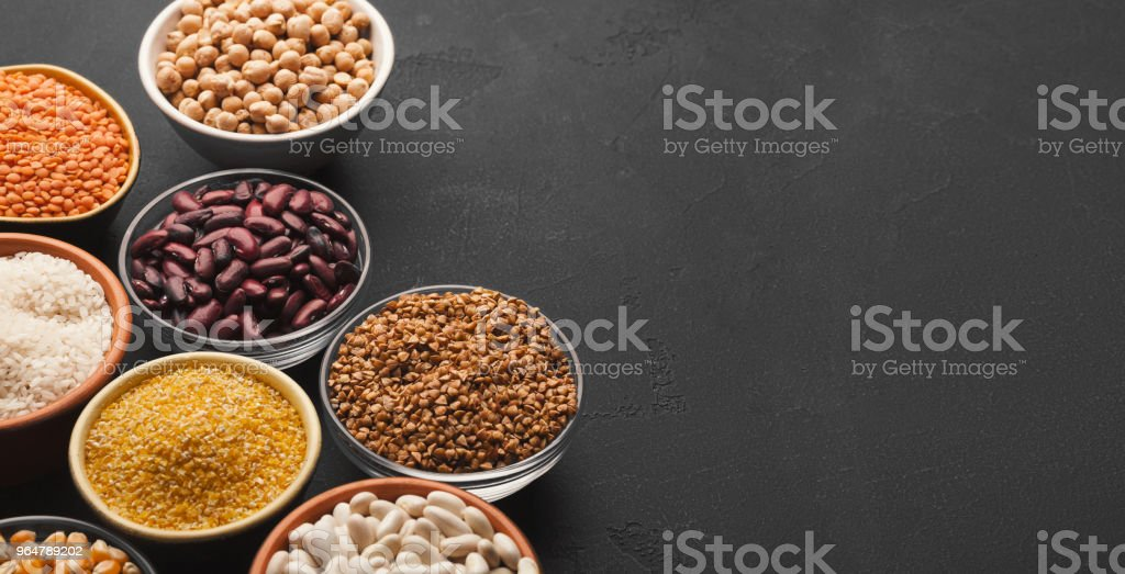 Various gluten free groats on black background with copy space royalty-free stock photo