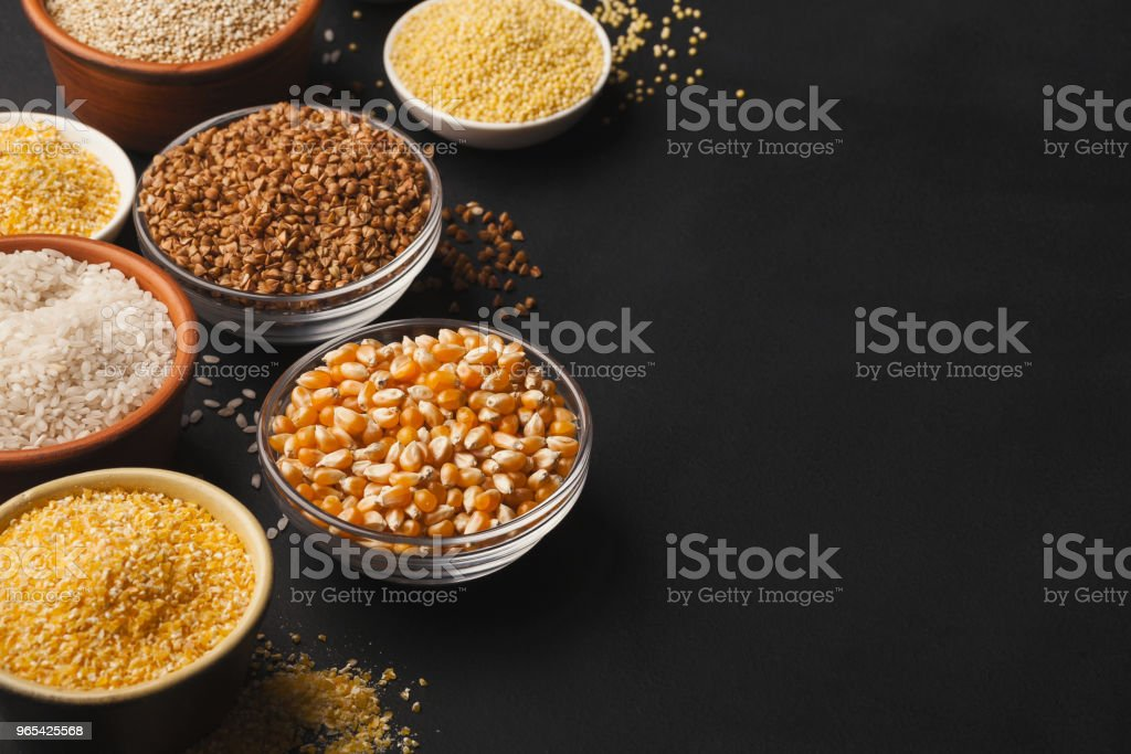Various gluten free groats on black background with copy space zbiór zdjęć royalty-free