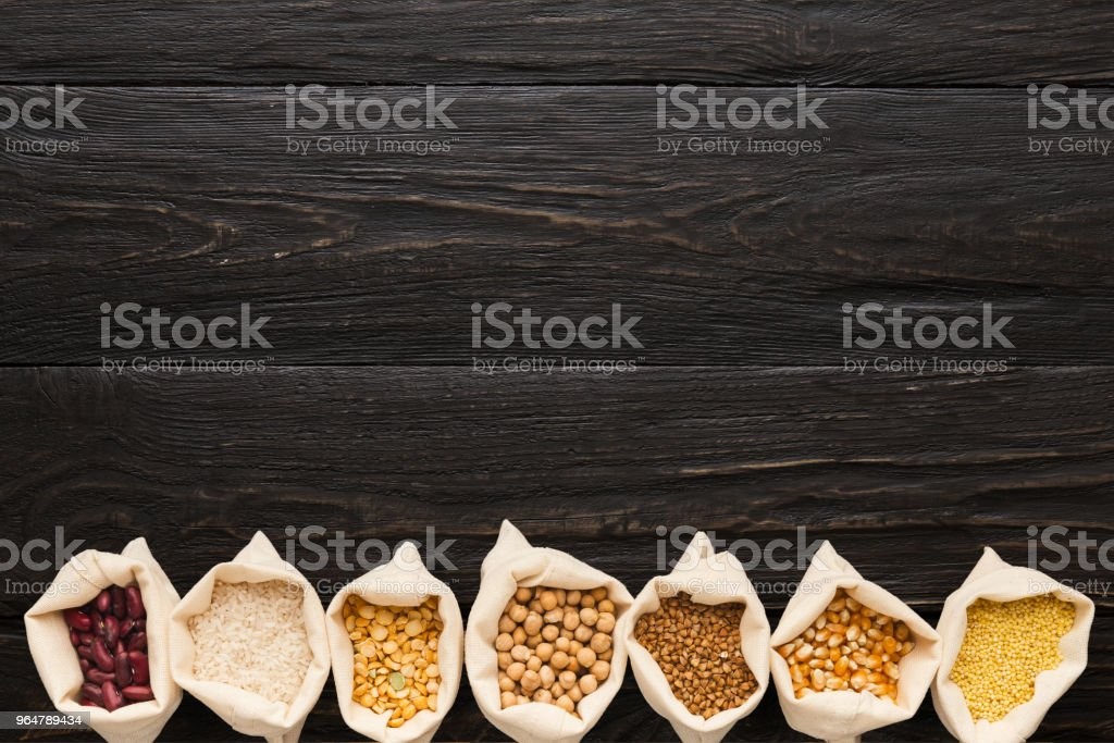Various gluten free groats on wooden background, copy space royalty-free stock photo