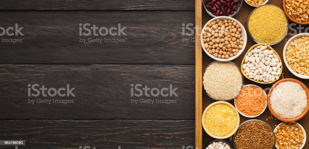 Various gluter free groats on wooden background, copy space royalty-free stock photo