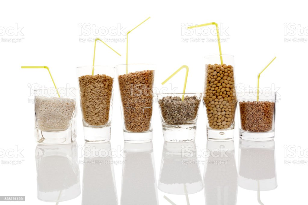 Various grains and seeds for making vegan milk stock photo