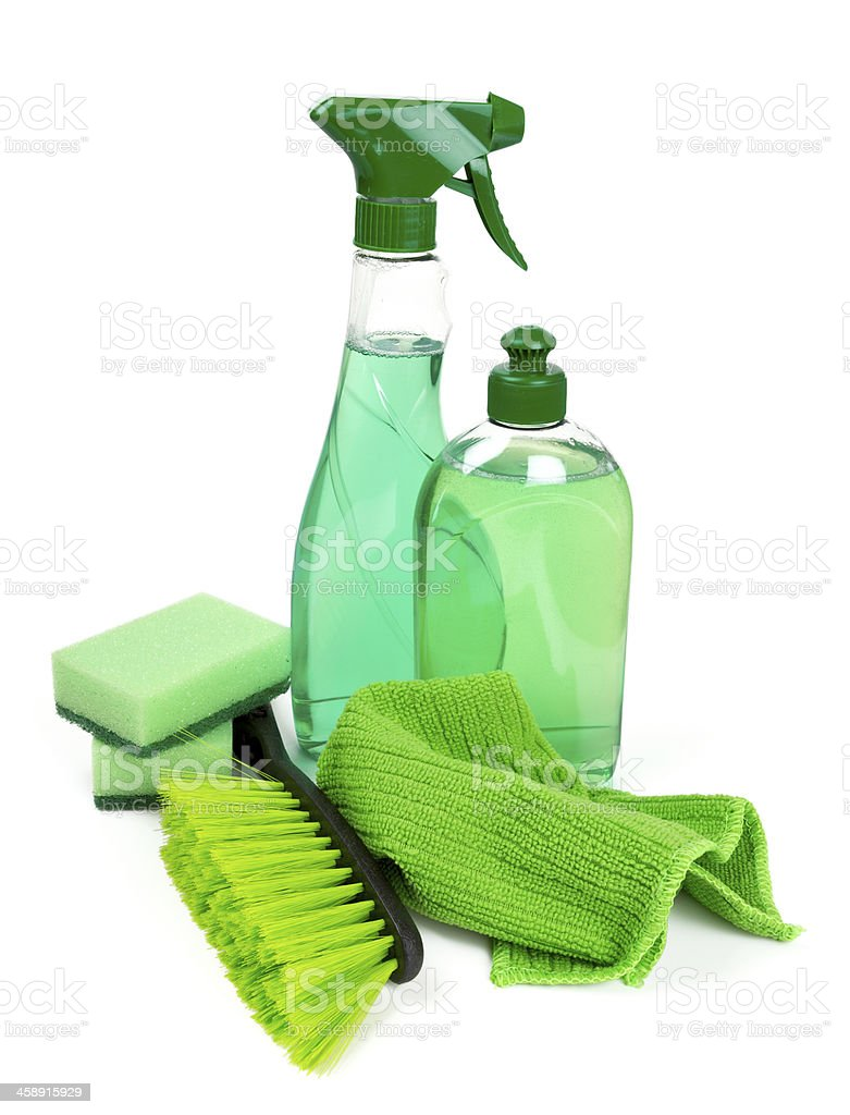 Various green cleaning tools isolated on a white background stock photo