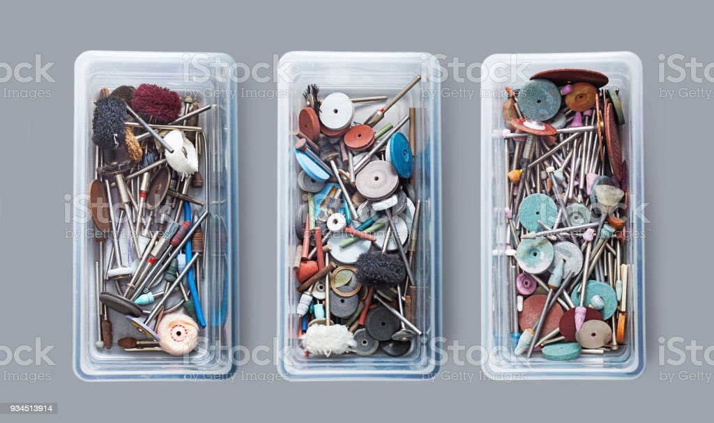 Various grinding and cutting tools in three plastic boxes stock photo