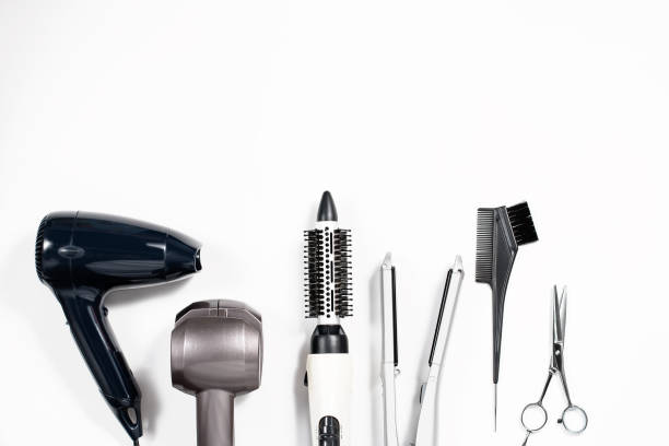 various hair styling devices on white background, top view - beauty salon stock photos and pictures