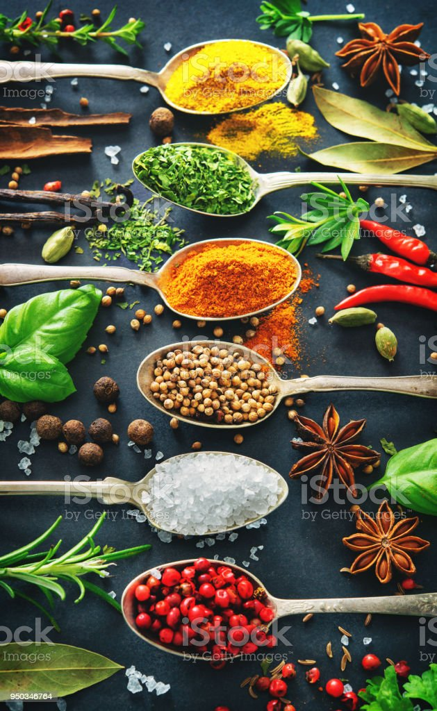 Various herbs and spices on dark background stock photo