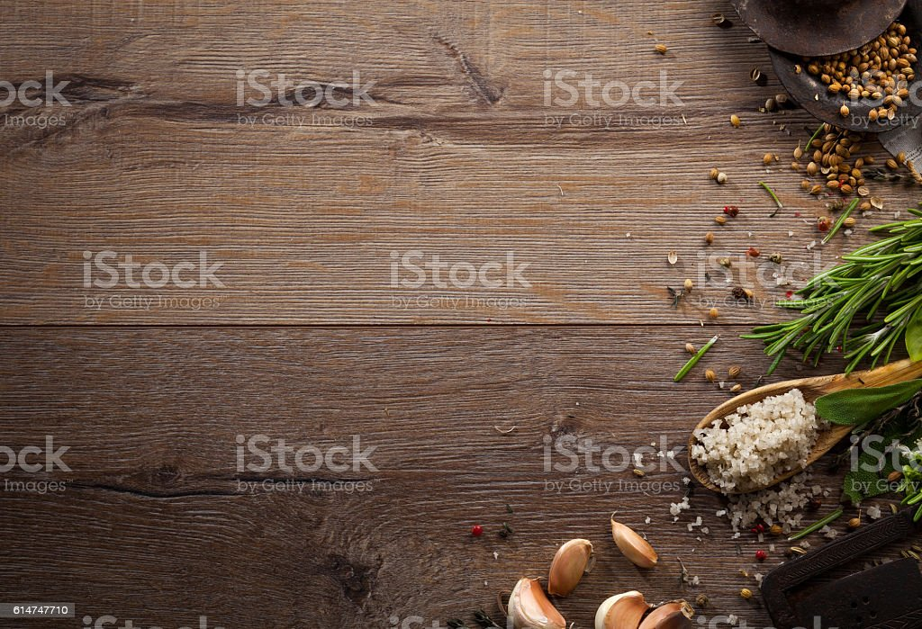 Various herbs and spices on dark wood table stock photo