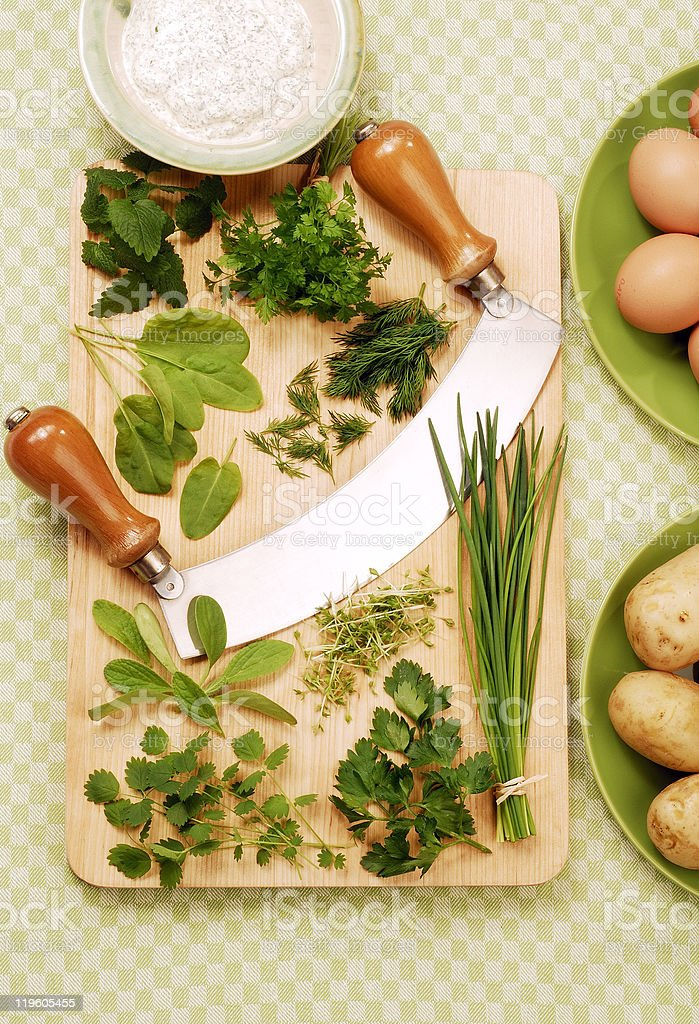 various herbs on a wooden cutting board royalty-free stock photo
