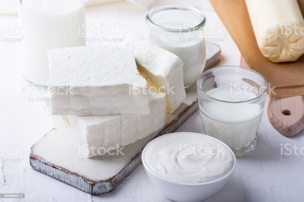 Fresh handmade farm butter on wooden board, various homemade organic...