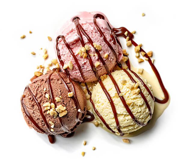 various ice cream balls with chocolate sauce - pinda voedsel stockfoto's en -beelden