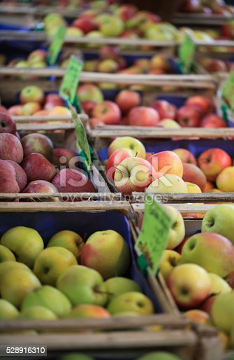 Apples in wooden boxes on a farmer's market.