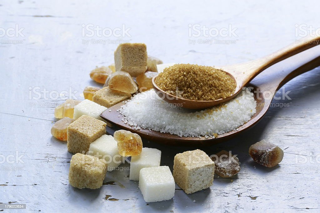 Various kinds of sugar, brown, white and refined stock photo