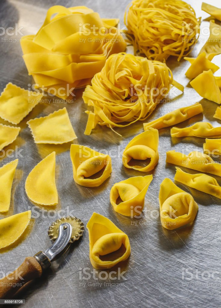 Various kinds of traditional italian really homemade pasta, some stuffed. stock photo