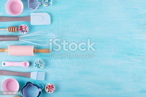 istock Various kitchen baking utensils. Flat lay. Top view, mockup for recipe on blue background. 1014613924