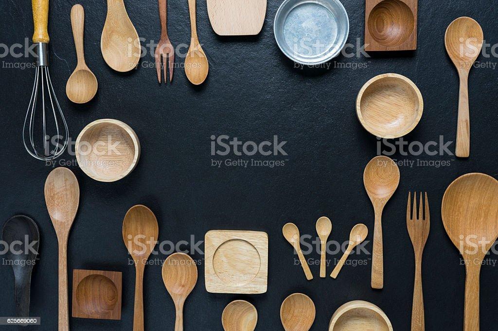 various kitchen utensils on black table background stock photo
