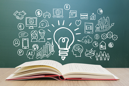Various knowledge and blackboard backgrounds for learning through reading - smartphones, computers, networks, and business ideas.
