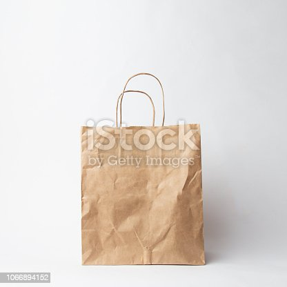 istock Various kraft paper bags and wrapping paper isolated on white background 1066894152